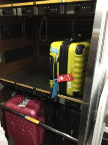 There's a separate cabin for luggages located just before the exit door.